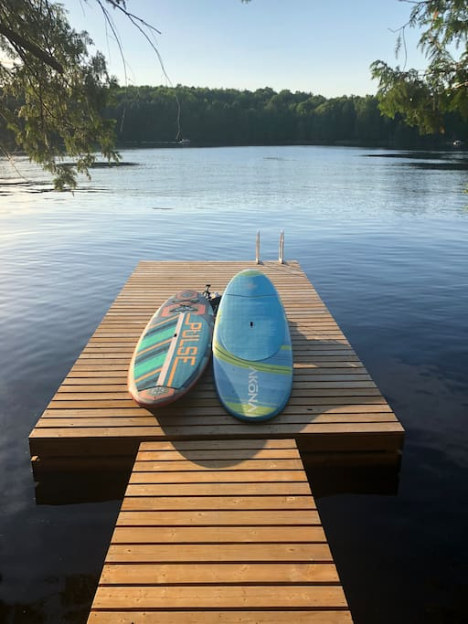 Beautiful lake, dock, and paddle boards for your pleasure