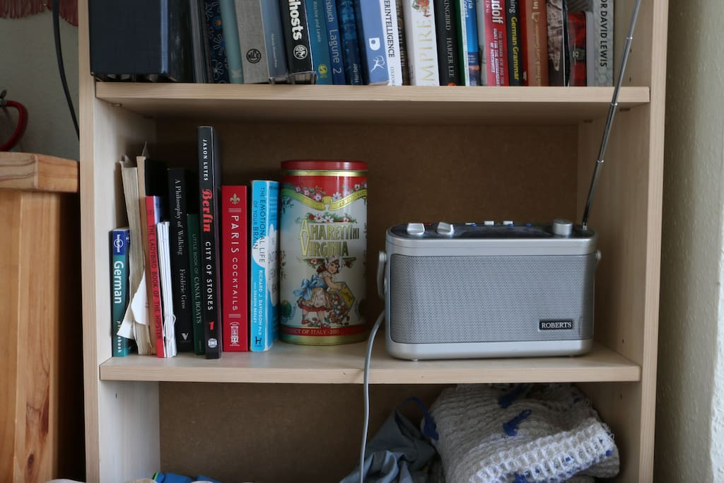 Feel free to use the radio and flick through my little collection of books.