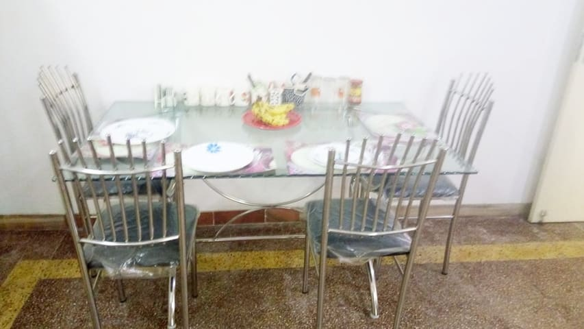 Dinning Room / table to accomodate 6  people comfortably.  French crockery and cutlery and optional we have stainless steel ware for your convenience.