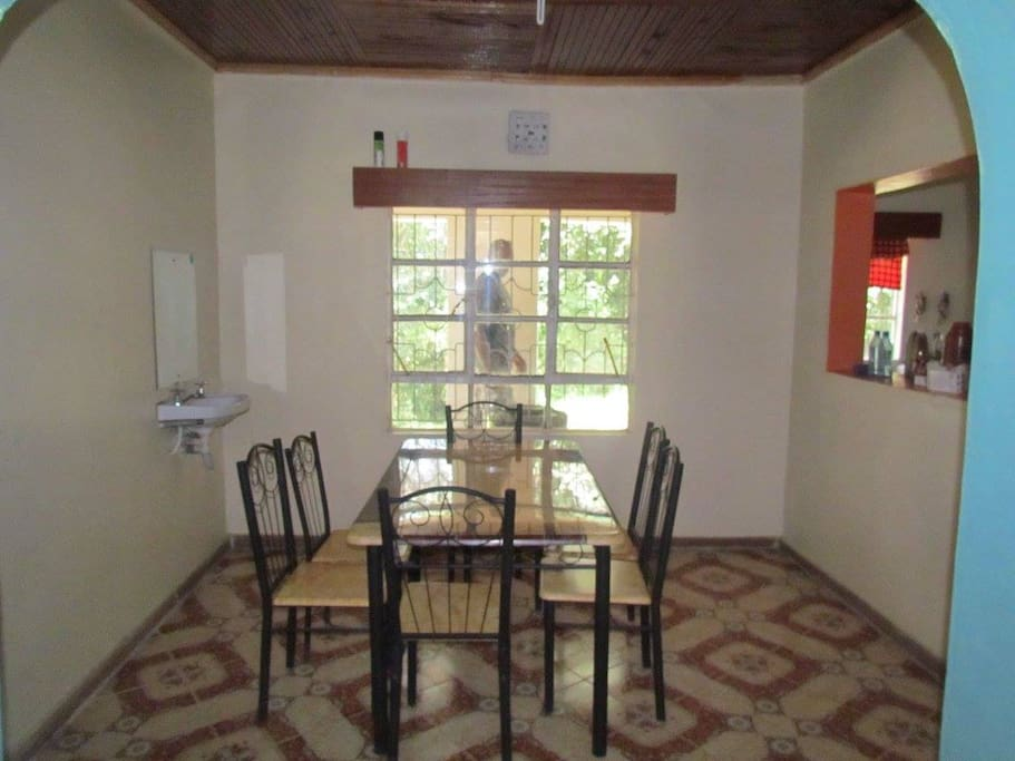 The dining room, which has a window into the kitchen.