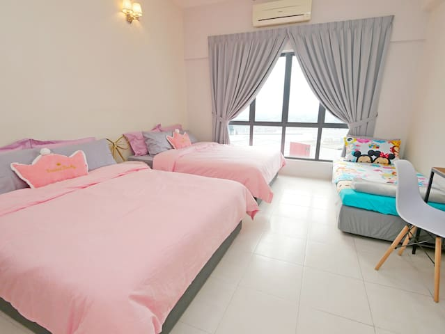 Master bedroom with 2 queen size bed,  1 single size bed, attached bathroom, working table, designer chair, full block-out curtain for undisturbed sleep.