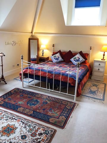 Spacious double accommodation with metal frame king-sized bed.