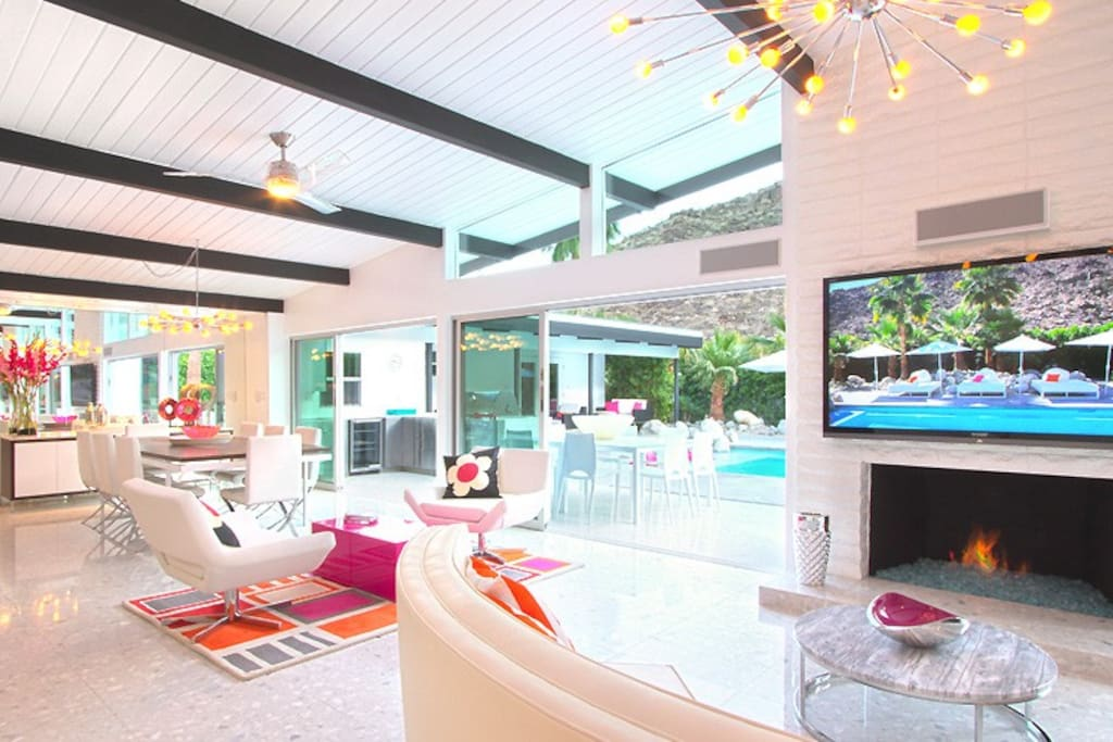 Mid-Century glam design and furnishings. Indoor/outdoor living. Bright, open and fun!