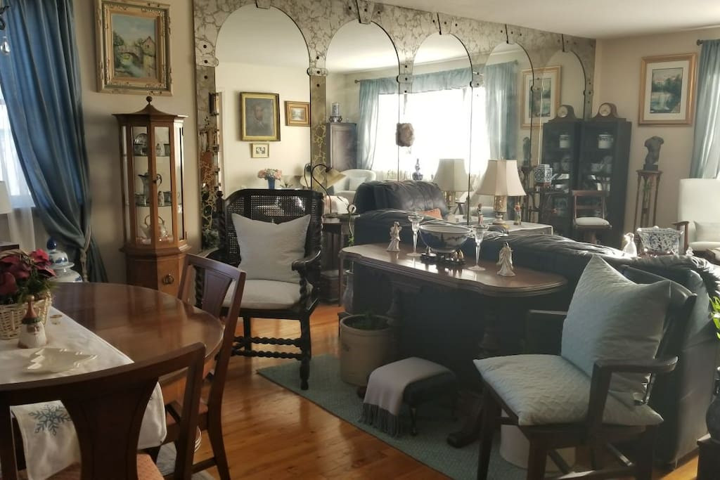 Beautiful and spacious dining room and living room, with antique decor. This is a shared space.