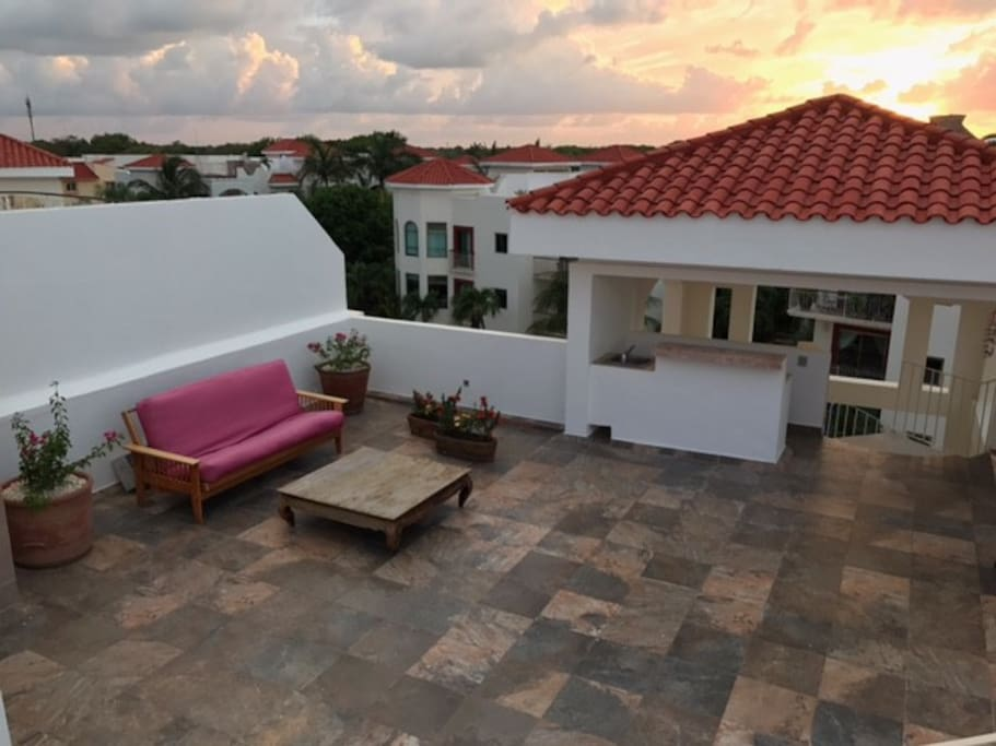 Watch the sunset from atop the spacious private rooftop.