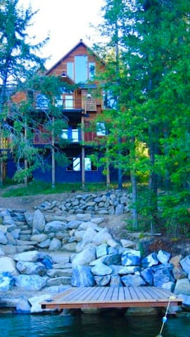 Wooded acres waterfront home with dock