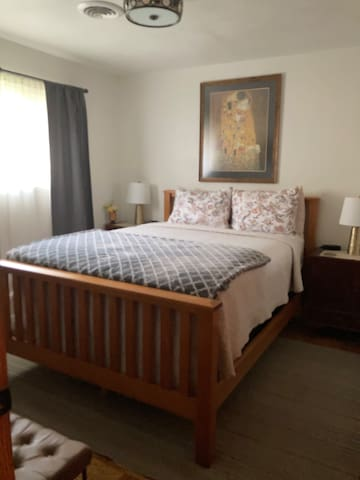 Queen bed with dresser. Extra sheets and blankets.  Roku tv in room