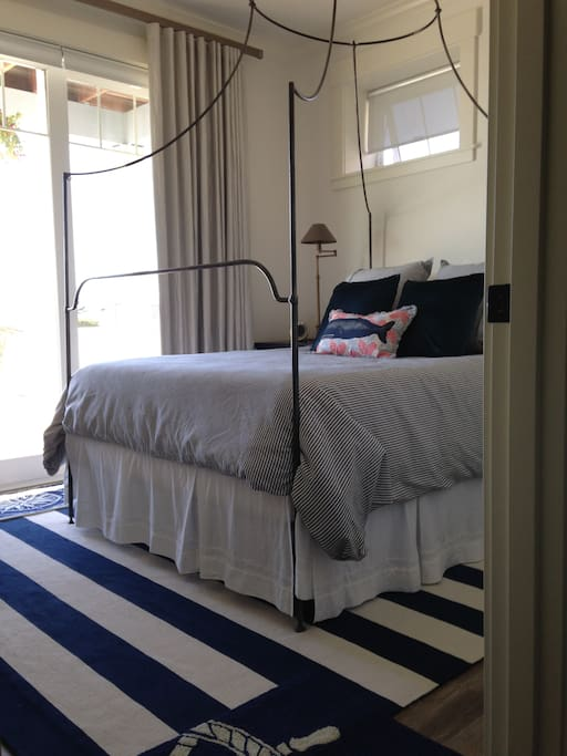Private bedroom with queen bed and fun nautical decor.