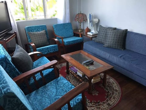 Living room with  lovely breezes and all the amenities to relax in this tropical island!