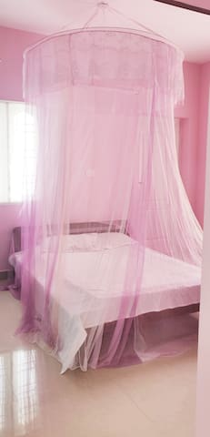 Bedroom 2 with Air condition,  Queen size Bed , Attached Western toilet , wardrobe , Balcony with washing machine and clothes drying area . All windows have mosquito net and beautiful mosquito net on bed.