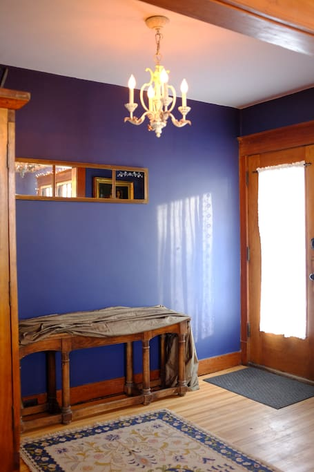 The entryway is spacious and features an armoire for your coats, as well as place to keep your boots and shoes.