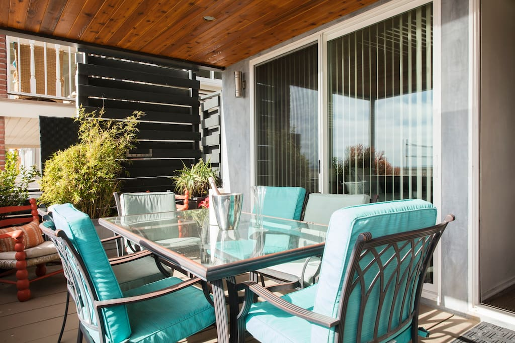 Enjoy al fresco dining on large cedar covered patio