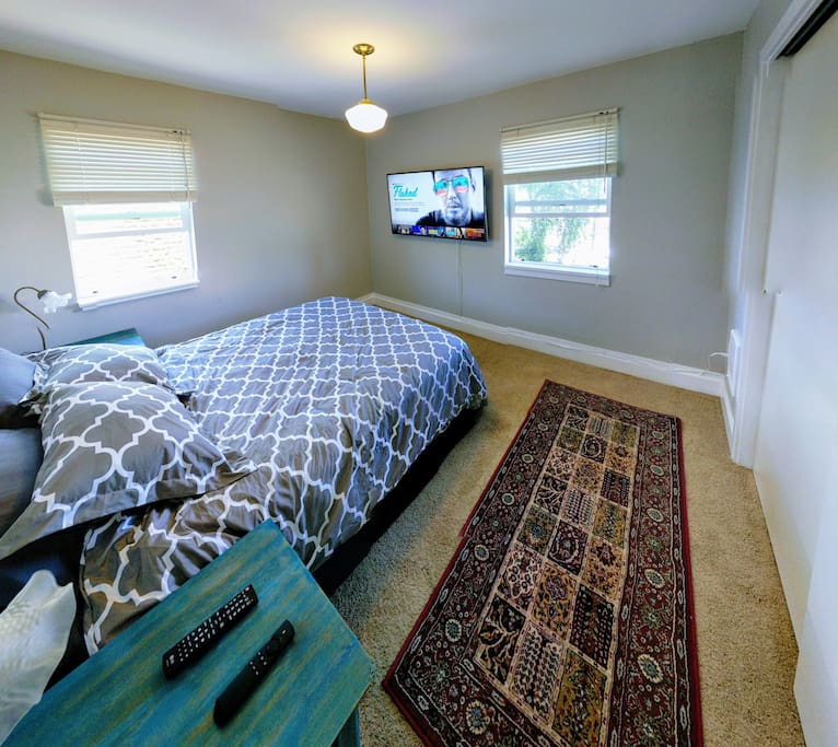 "The bedroom features a queen bed, a huge 55"" Smart HD TV with Netflix streaming, a window A/C unit, and a pocket door for privacy."