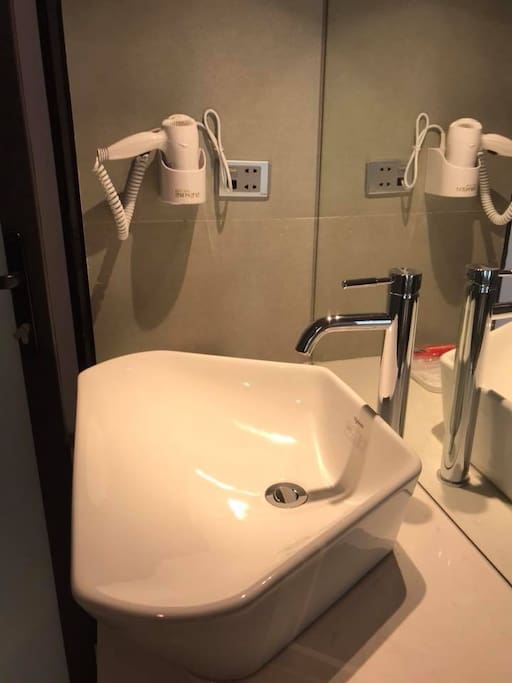 The bathroom with a big lavabo and hot water 24/7. Hairdryer is in the bathroom. Big mirror and modern shower.