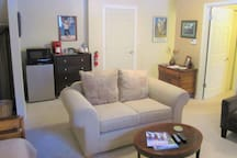Back of family room with refrigerator, microwave and coffee maker