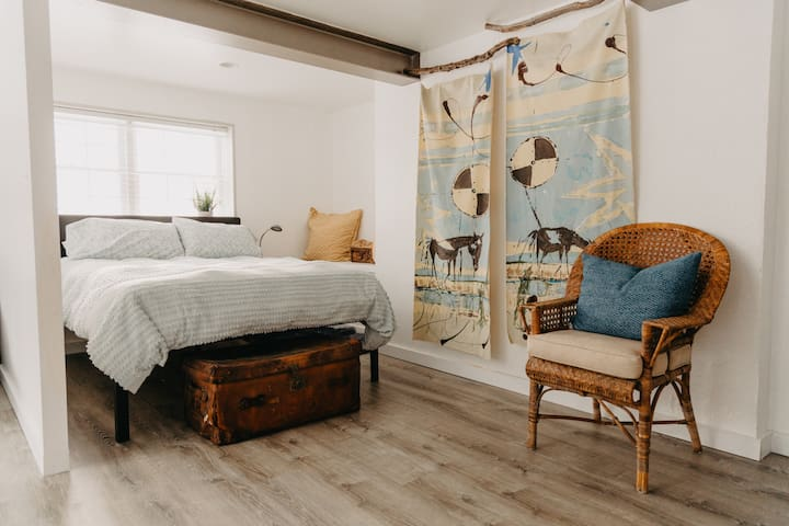 Queen size bed with original hand-painted tapestry by local Montana artists