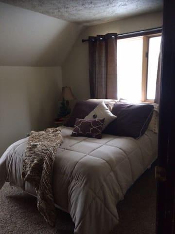 Bedroom 2 - located upstairs has a queen bed. Sleeps 2
