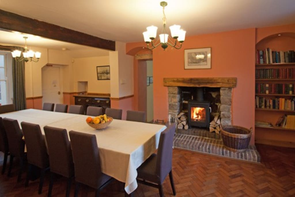 Dining room with wood-burning stove and seating for 14.