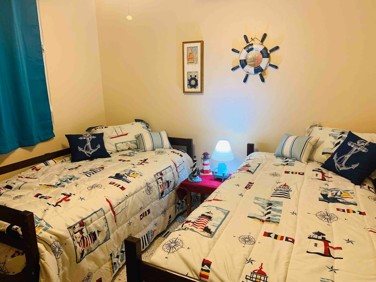 A Nautical theme room has been prepared paying attention to details to tickle your senses. Twin beds for anyone who wants to sleep with a sibling or a friend but still be comfortable.