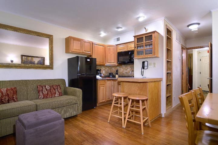 Spacious living room and dining room with TV and plenty of seating!