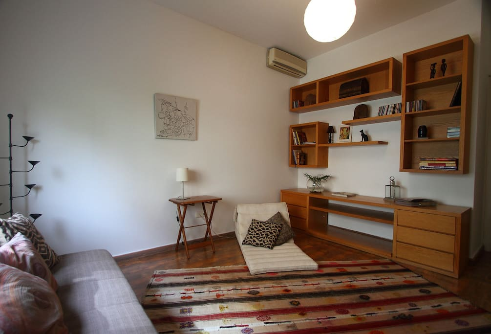 TV Room with single bed sofa bed