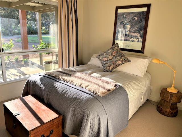 Bedroom 2  features garden views, TV, DVD player, querky upside down rice grinder bedroom side tables  and plentiful snoozy afternoon sun.