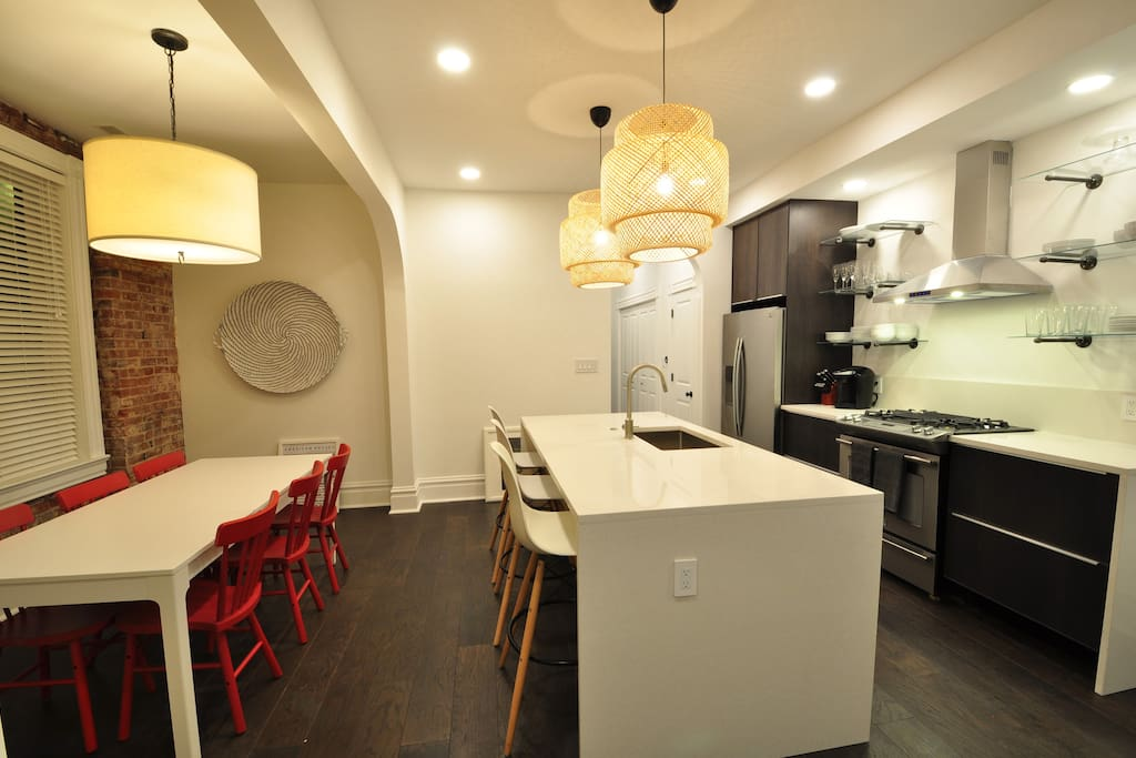 Separate dining area with exposed brick