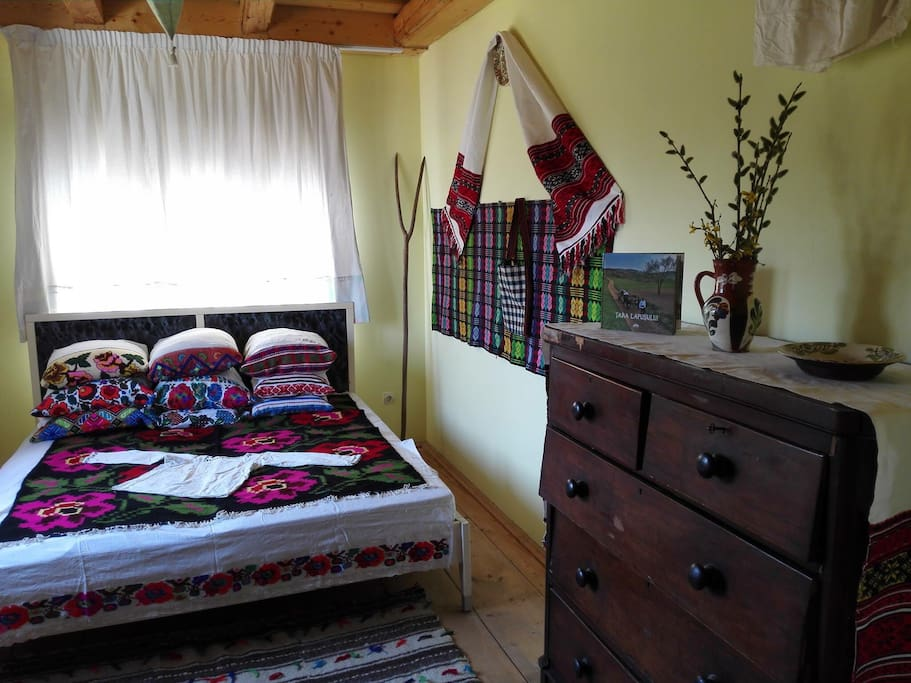 Double room in modern house Casa Carolina in the sleepy village of Cupseni, Țara Lapusului. The property spread over one hectare of land with views to Șatra and Gutai mountains has traditional Maramures houses around.