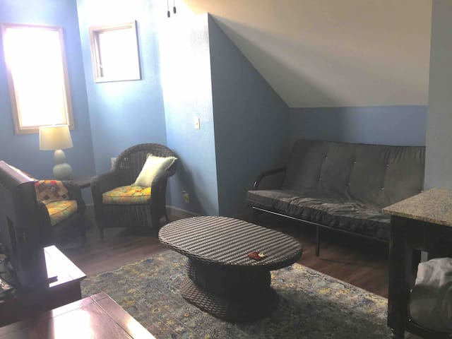 This upstairs sitting area offers a futon for additional sleeping as well as reading nook and a television with dvd player and several family friendly dvds.
