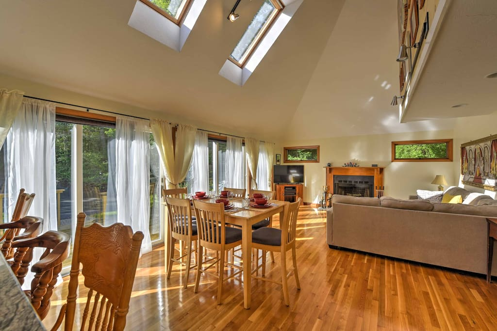 Vaulted ceilings, beautiful wood floors. and floor-to-ceiling windows embellish the main living space of the home.