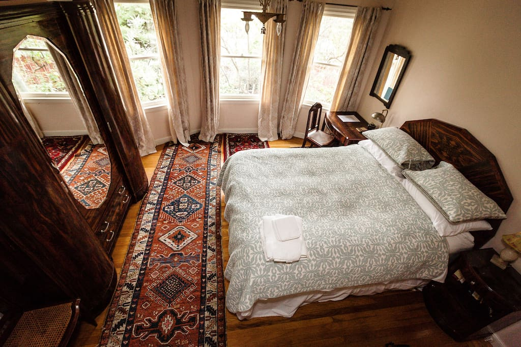 Birds eye view. Down comforter and down/feather pillows with very nice sheets.