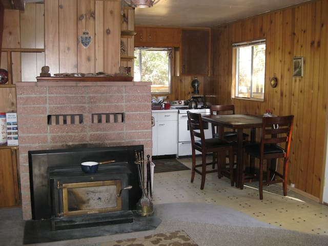 Downstairs: wood stove, dining and part of kitchen