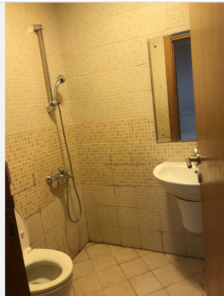 A room with attached bathroom