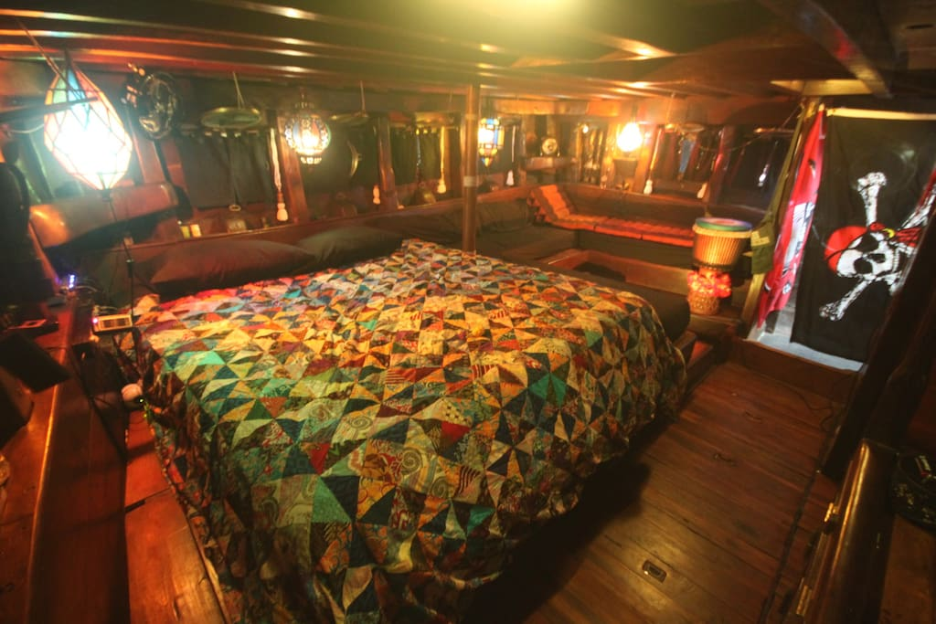 The master cabin has king size bed, lounge area, and private bathroom