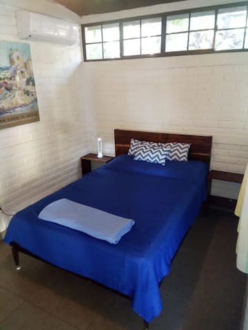 Master bedroom: a double bed and a private bathroom
