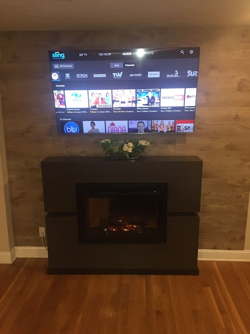 "Electric fireplace and 65"" smart tv, fire stick with Kodi included."