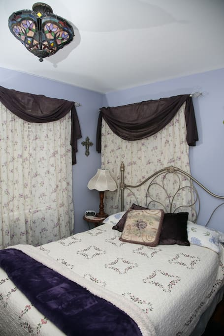 First floor bedroom with full bed