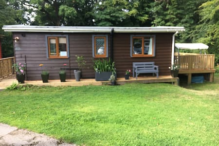 Luxury Riverside Cabin near Snowdon & Caernarfon