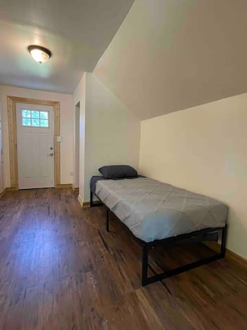 This sleeping arrangement is located in the hallway dowstairs. This bed can be moved upstairs or into the living room upon request as well.