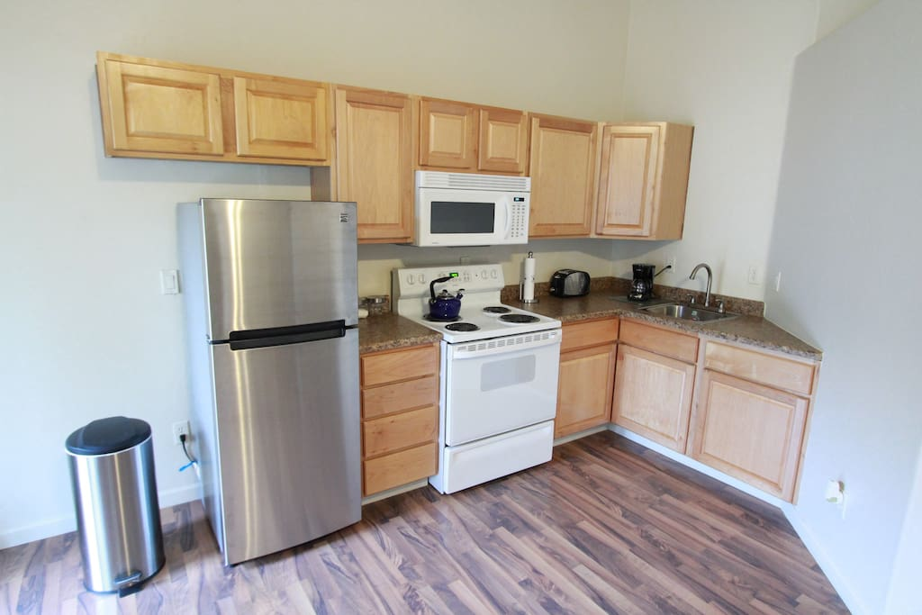 Brand new fridge, microwave, electric range, toaster, coffee maker