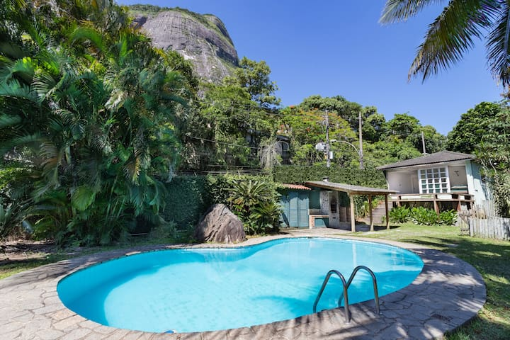 Villa with lush tropical garden, pool and view.
