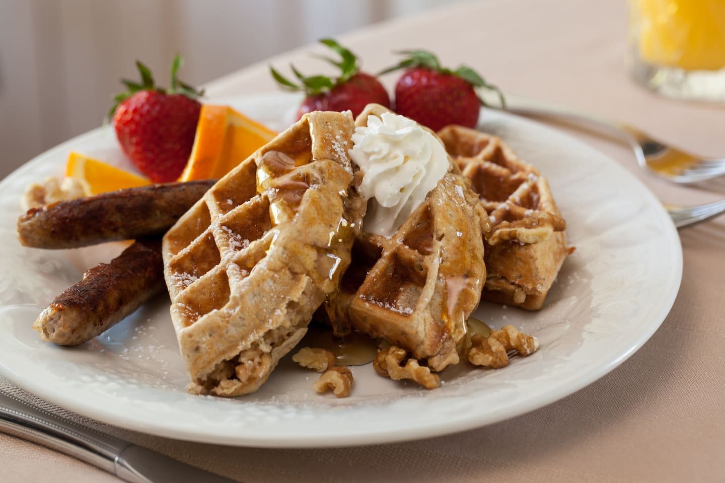 Whole grain cinnamon walnut waffles and local sausage to start your day.