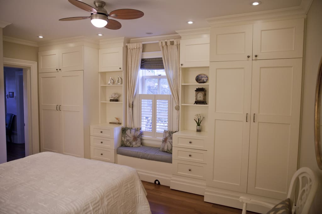 Window seat, closets and drawers.