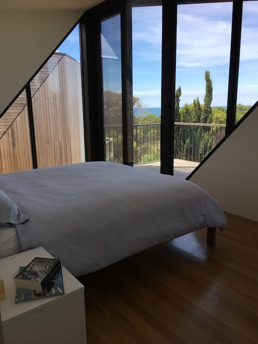 If you're in charge of this booking, you get THIS room! :)  Master with KB and ensuite bathroom and walk-in robe; balcony and sliding door with fly screen that can be left open at night to hear the ocean roar...