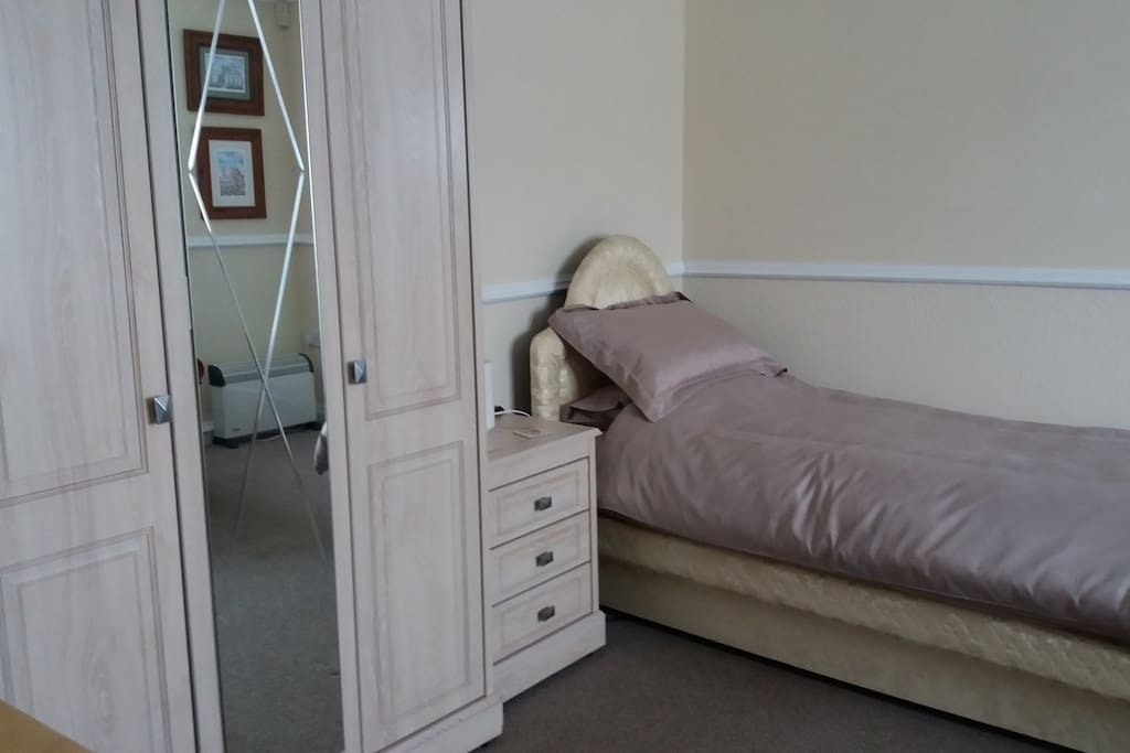 Bed, bedside chest and wardrobe