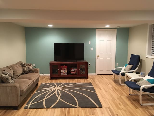 Large open floor plan: living room with big screen T.V. and seating.