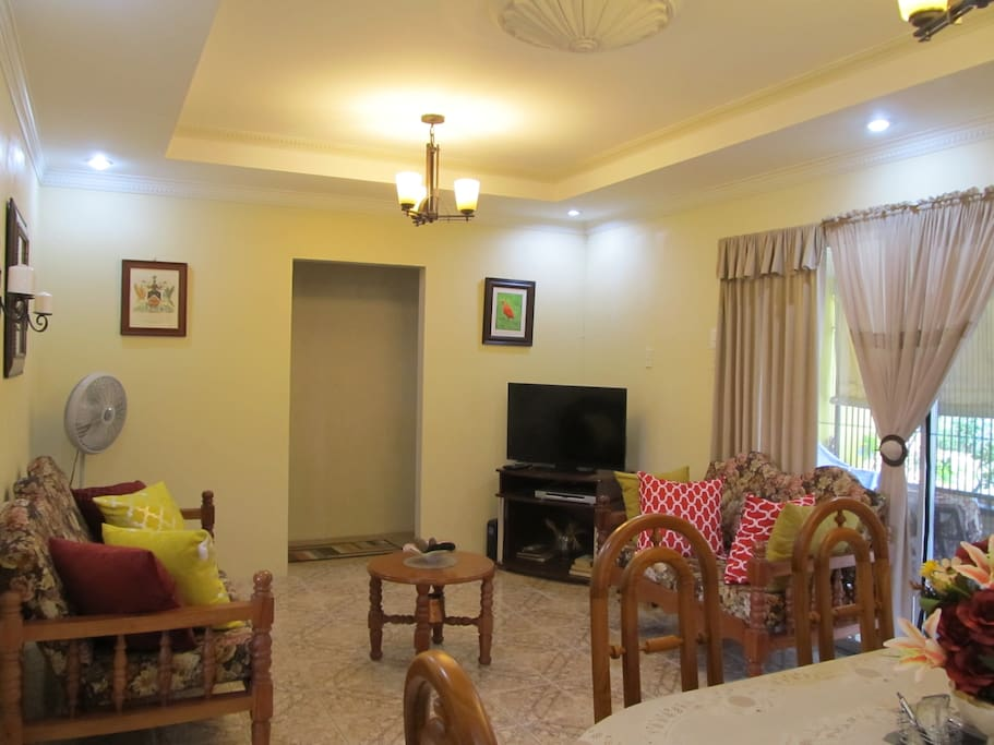 Relax and enjoy family time after a long day in our cool air-condition Living room & dining room (View 1)