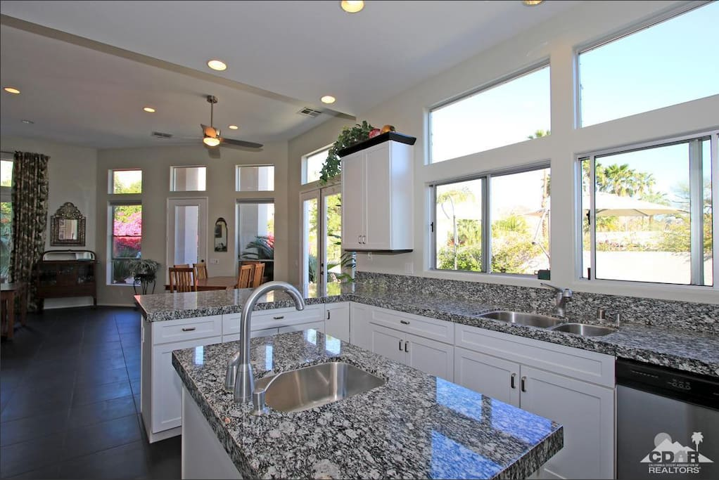 Chef's kitchen with breakfast bar, prep island and adjacent dining area