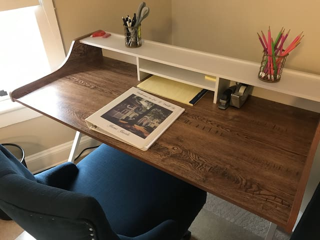 A desk with a comfy office chair - set up your laptop, connect to the high-speed WiFi, and get some work done, send some emails, or stream your favorite shows.