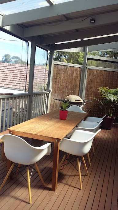 Covered rear deck, worry free BBQ dining